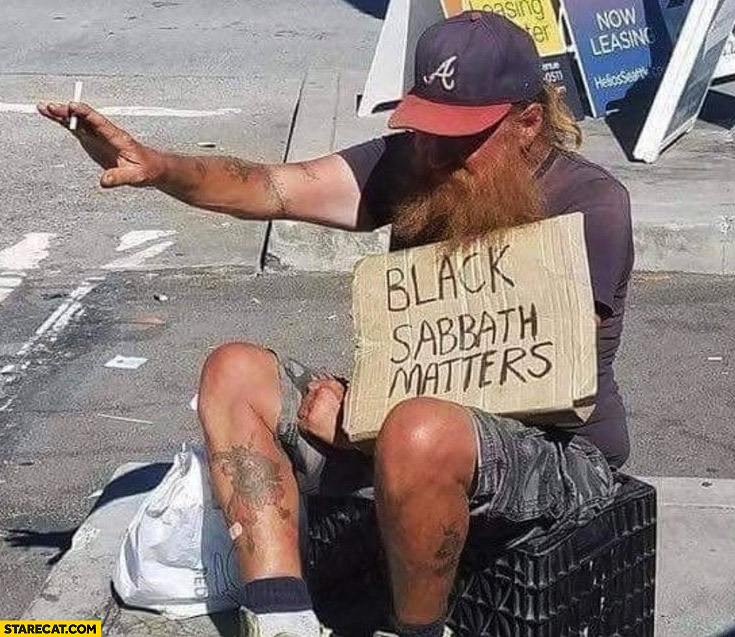 black-sabbath-matters-guy-with-a-sign.jpg